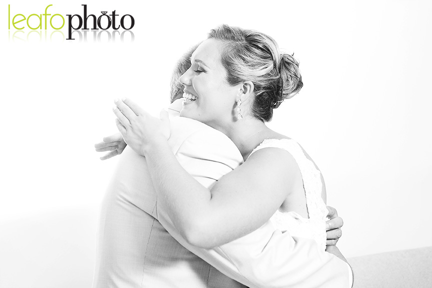Sweet photo of bride hugging father on wedding day