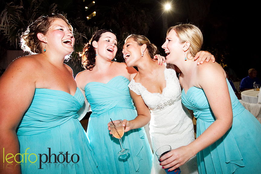 bride and bridesmaids singing during reception