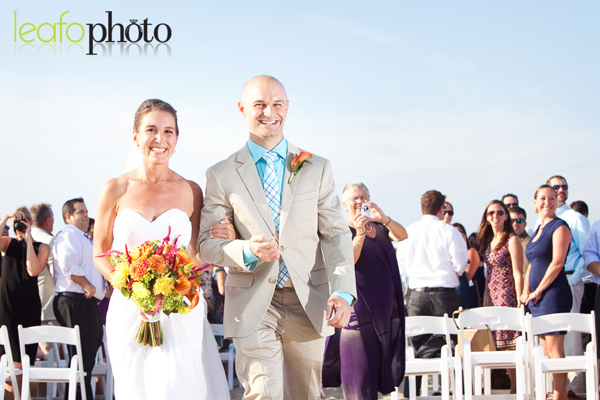 Delaware-Beach-Wedding-Photographers, Wedding Couple Walking Down Aisle After Beach Wedding