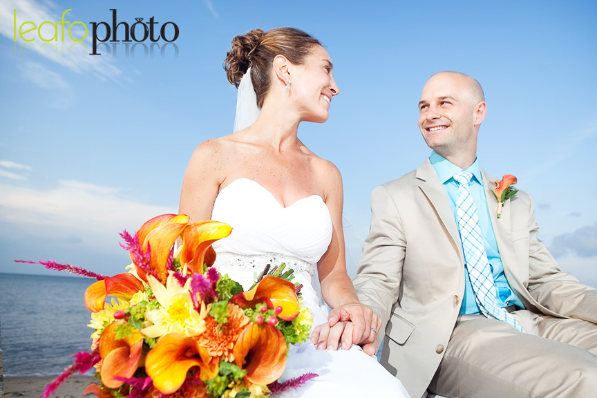 Quirky-Delaware-Wedding-Photographers, Bride And Groom Holding Hands at Beach