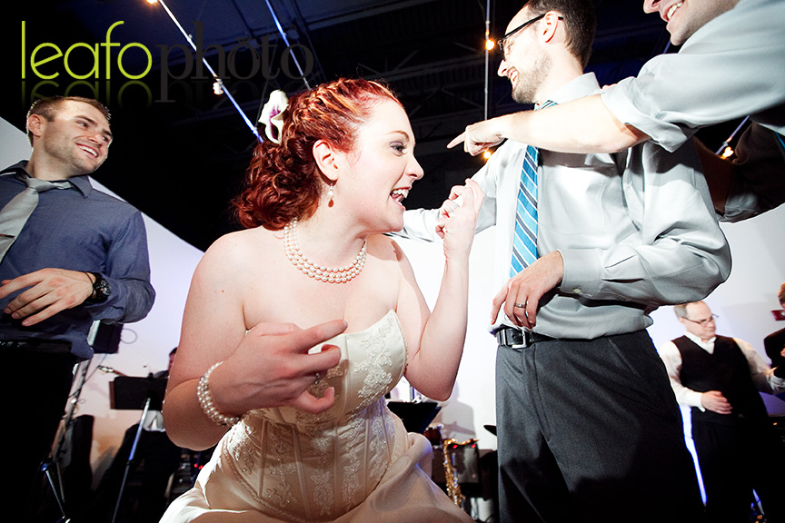Awesome-Delaware-Wedding-Photographers, Bride playing air guitar with teeth